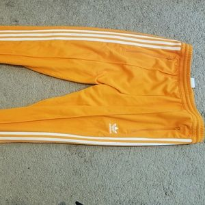 Orange adidas track pants